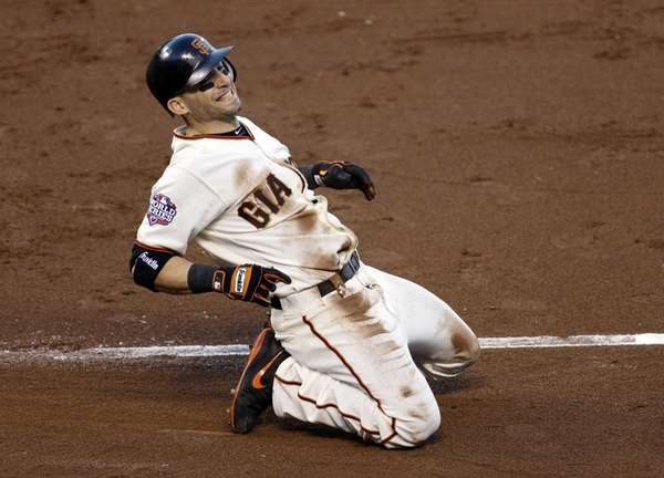 San Francisco Giants infielder Marco Scutaro reacts after