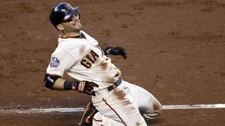 San Francisco Giants infielder Marco Scutaro reacts after