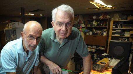 Joel Becker, left, and Peter Harrington volunteer to