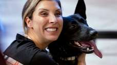 Carmela Raguso of Commack hugs MTA police dog