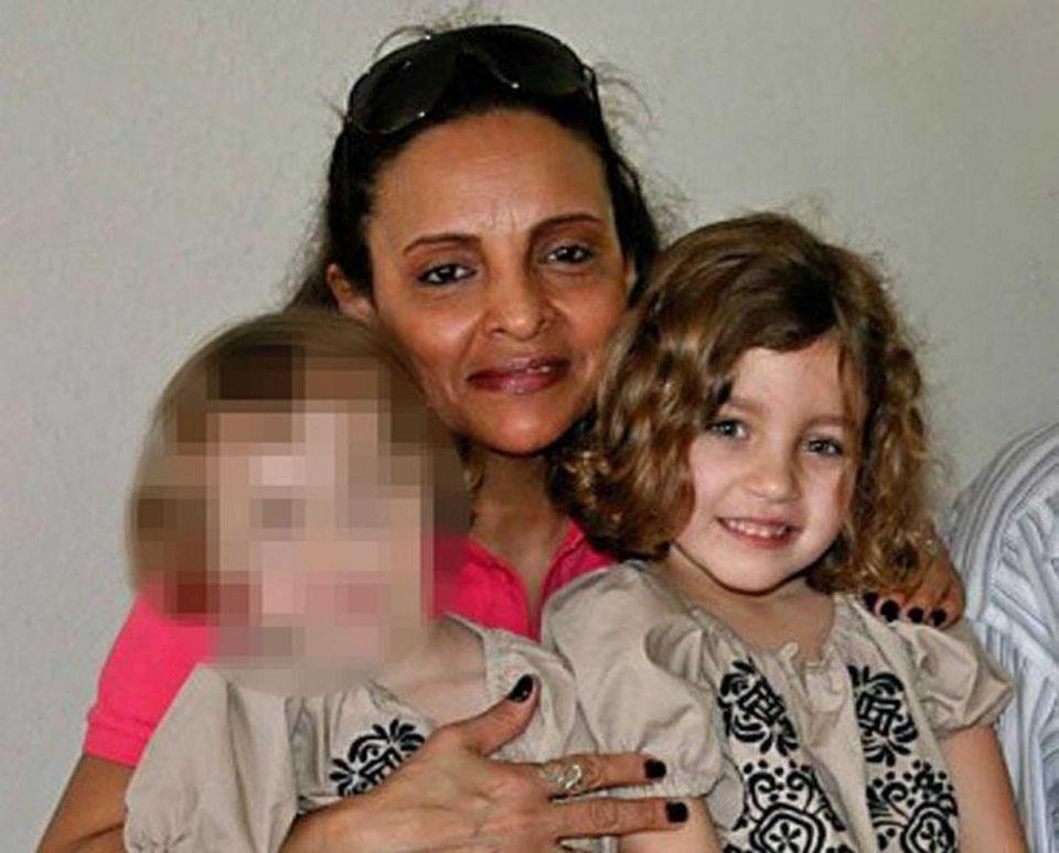 Nanny Yoselyn Ortega is shown holding Lucia Krim,