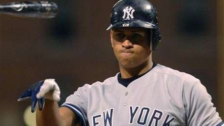Alex Rodriguez tosses his bat in disgust after