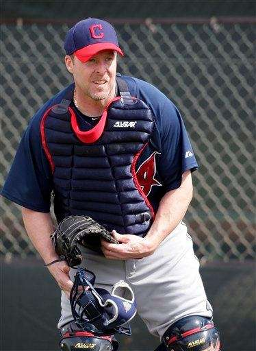 Mike Redmond collects his gear during spring training