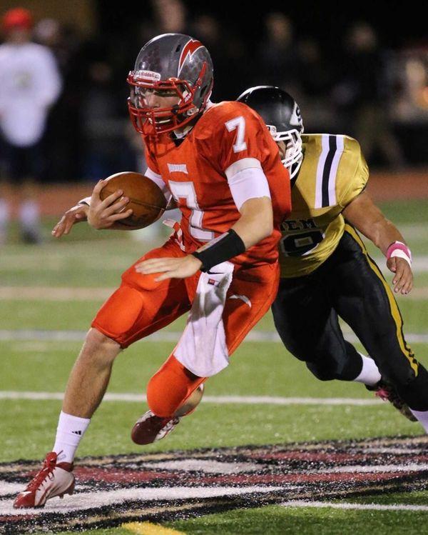 Connetquot quarterback Brian McKean scrambles for a first