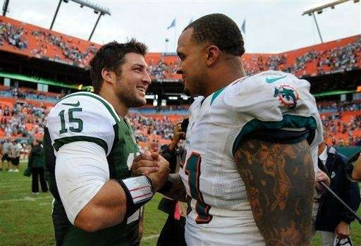 Tim Tebow and Miami Dolphins center Mike Pouncey