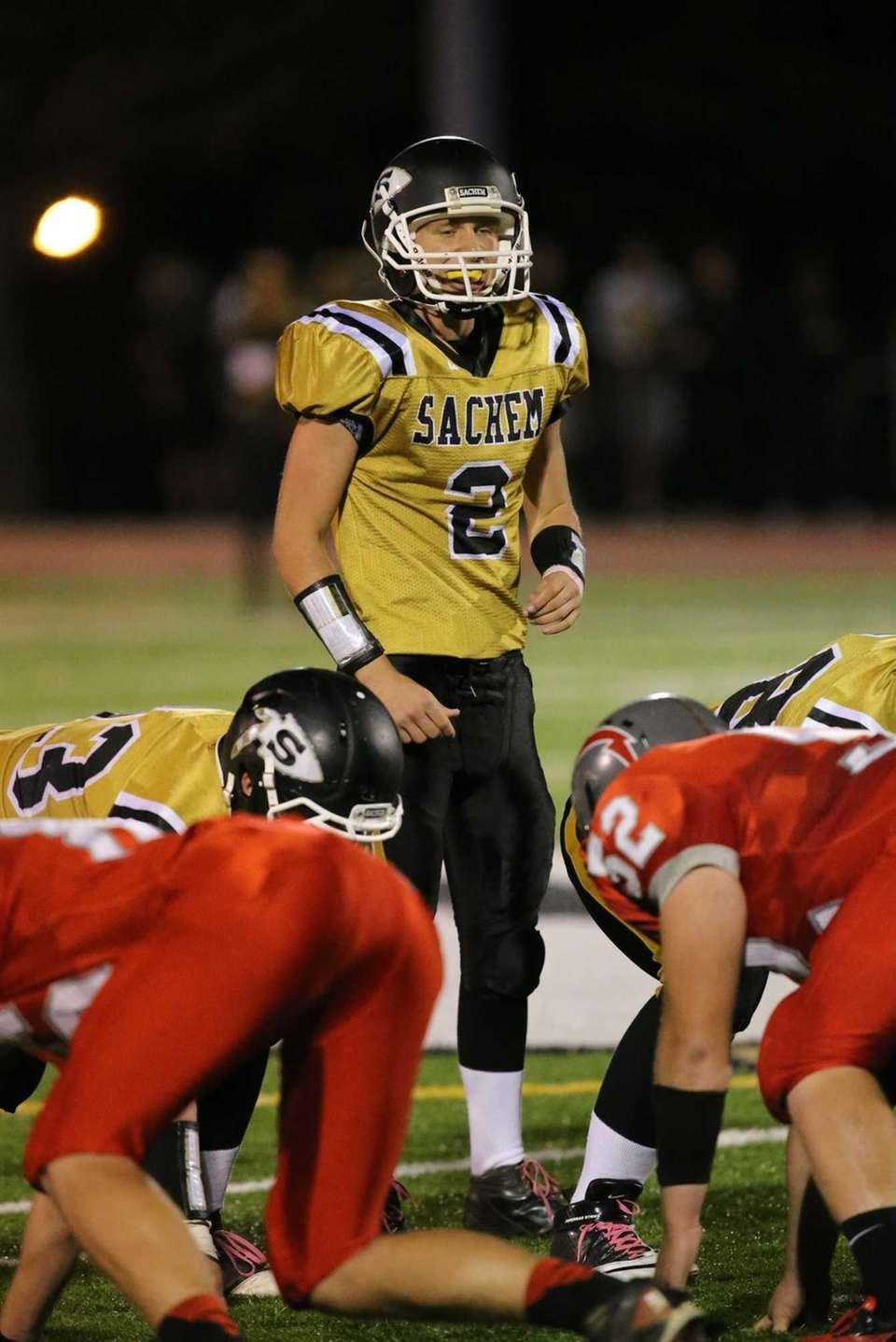 Sachem quarterback Mike O'Donnell calls an audible during