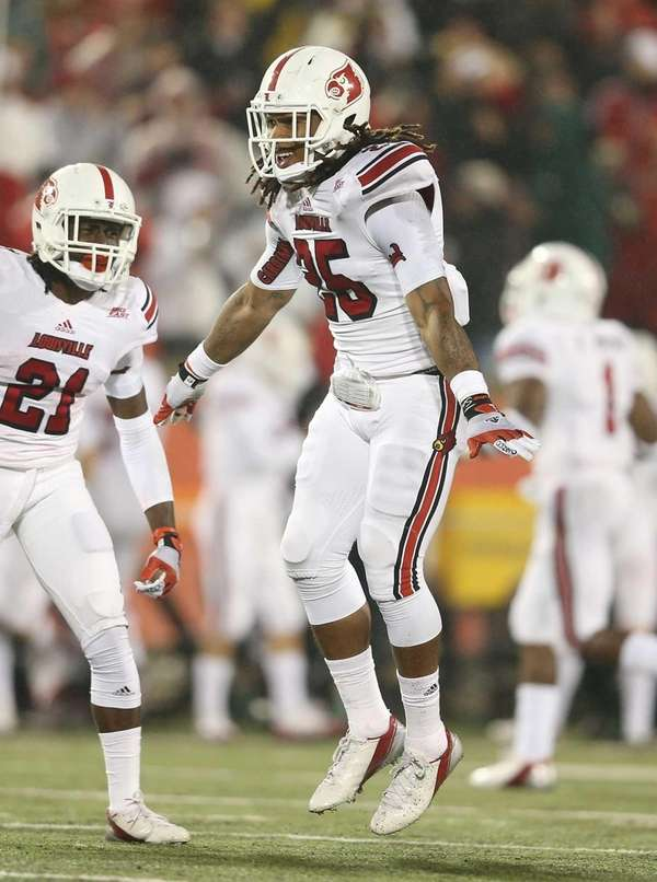 Calvin Pryor of the Louisville Cardinals celebrates after