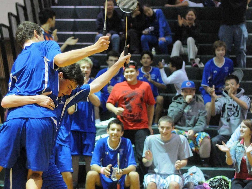 Long Beach High School teammates Justin Barry, left,