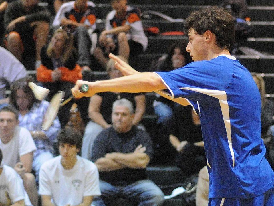 Long Beach High School senior David Fuchs serves