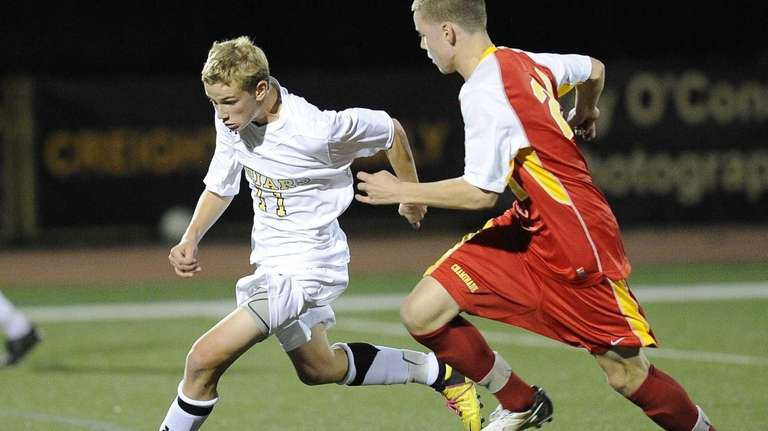 St. Anthony's Justin Carfora controls the ball defended