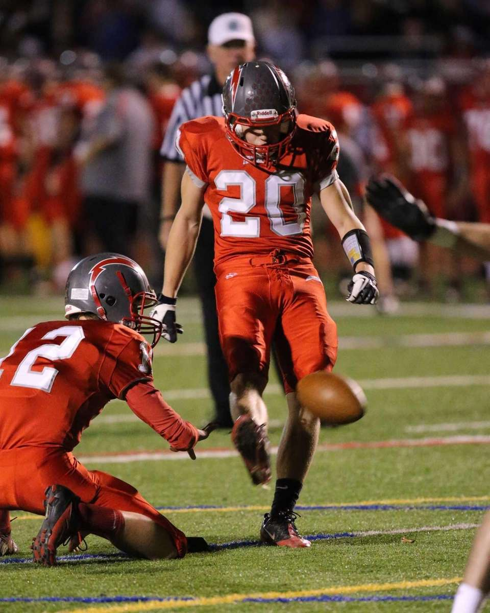 Connetquot's Will Kistinger kicks the extra point in