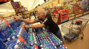 Edward Ogonowski stocks up on bottled water at