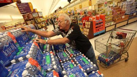 Edward Ogonowski stocks up on bottled water at