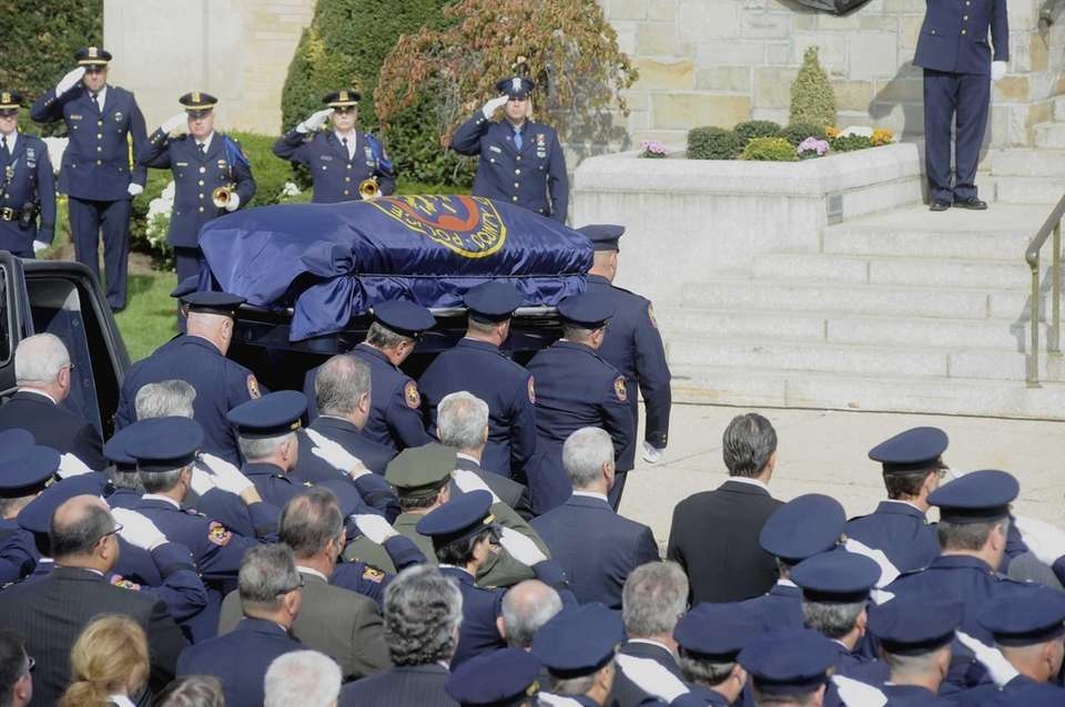 Family, friends and police officers gather at St.