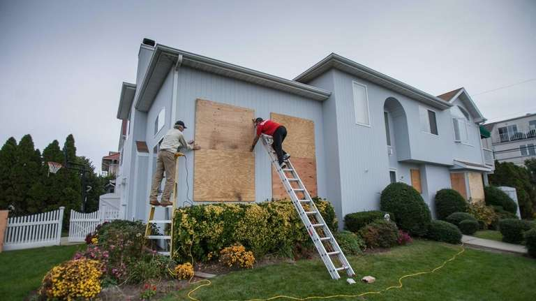 Frank Forcinom, 50, of Long Beach, helps his