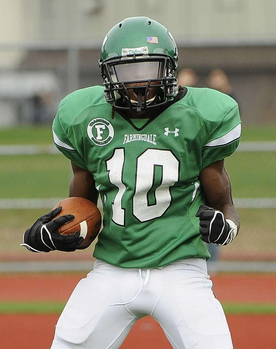 Farmingdale's Curtis Jenkins reacts after scoring a fourth-quarter