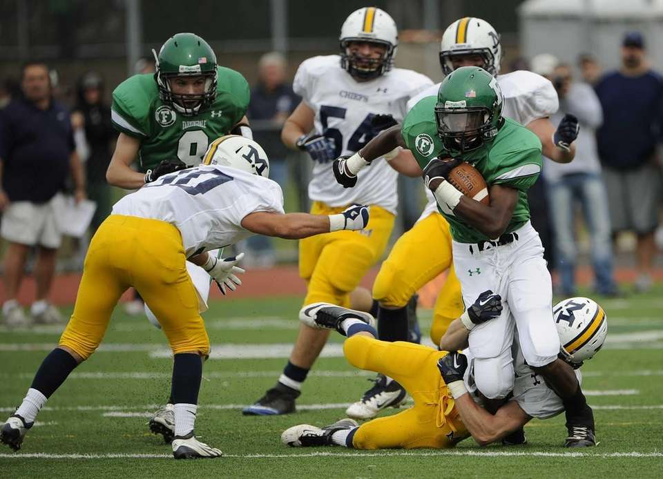 Farmingdale's Curtis Jenkins runs for a first down
