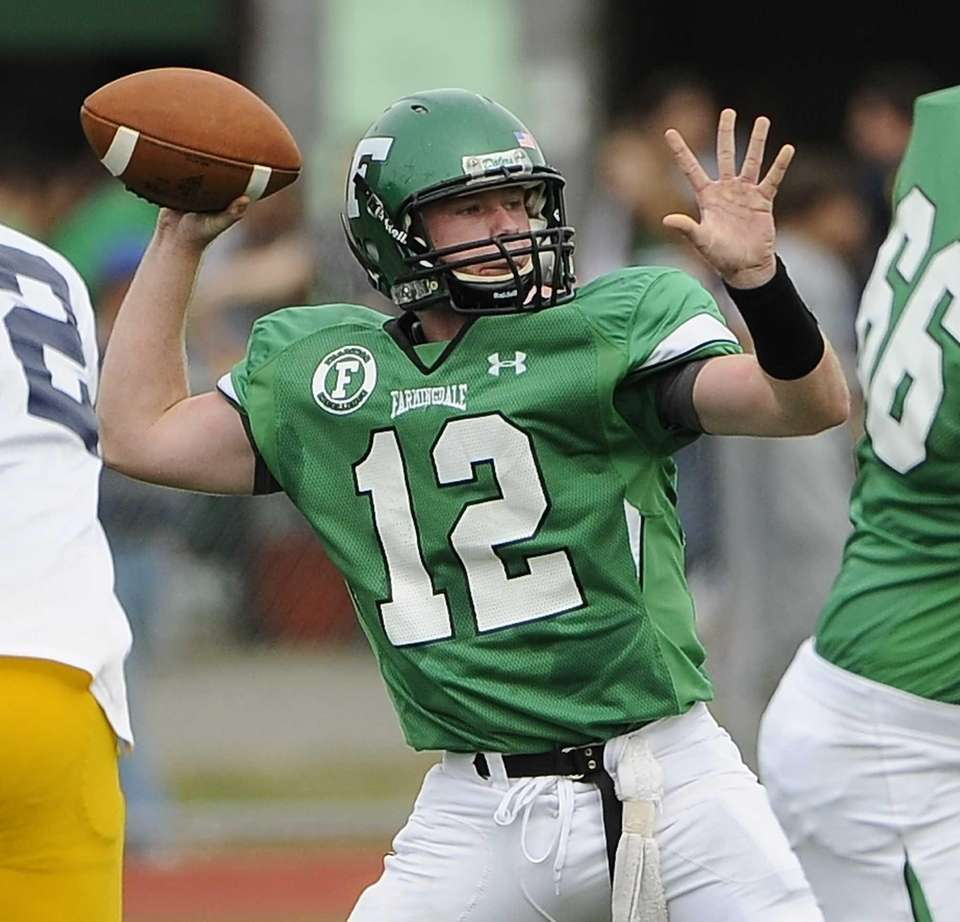 Farmingdale quarterback Joe Valente throws a pass against