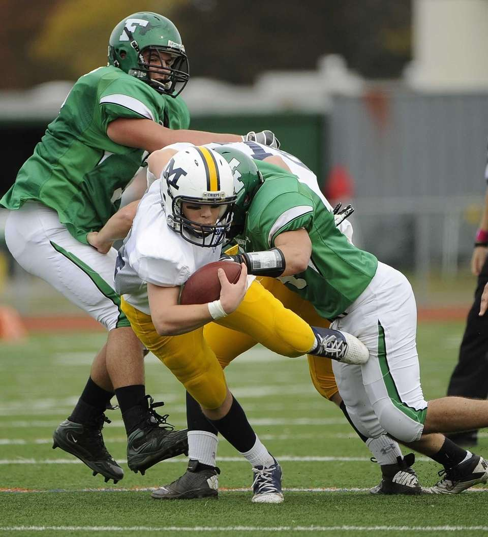 Farmingdale's Matt Dittmeier tackles Massapequa quarterback Paul Bentz