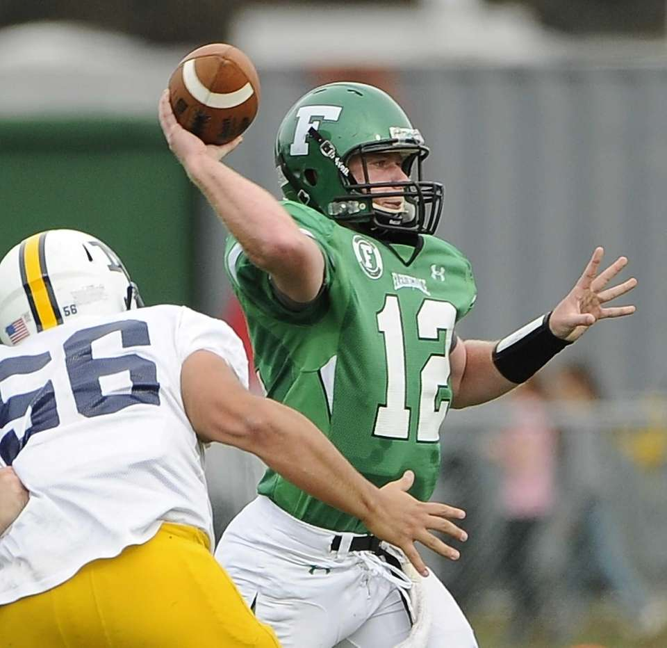 Farmingdale quarterback Joe Valente throws a screen pass