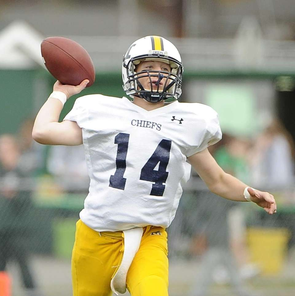 Massapequa quarterback Paul Bentz passes the ball against