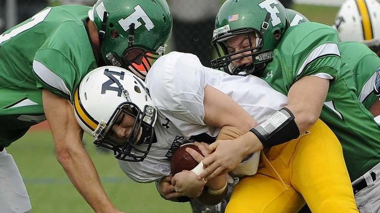 Farmingdale's Ryan Feiner, right, and Drew Marlow, left,