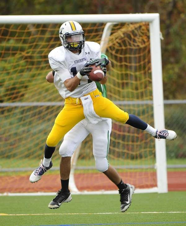 Massapequa's Craig Berge makes the catch ahead of
