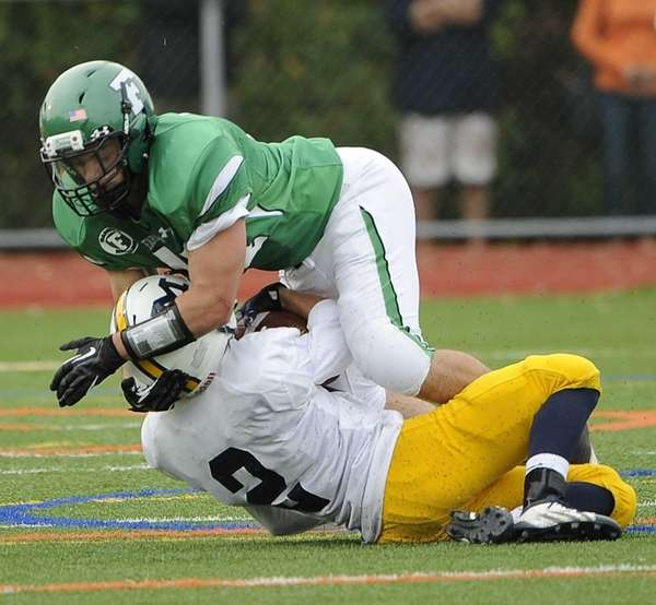 Farmingdale's Matt Dittmeier tackles Massapequa's Harry Lowe in