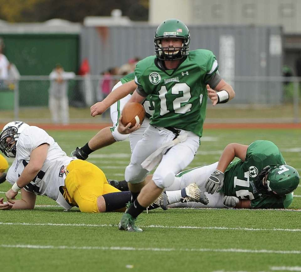 Farmingdale quarterback Joe Valente runs the ball against