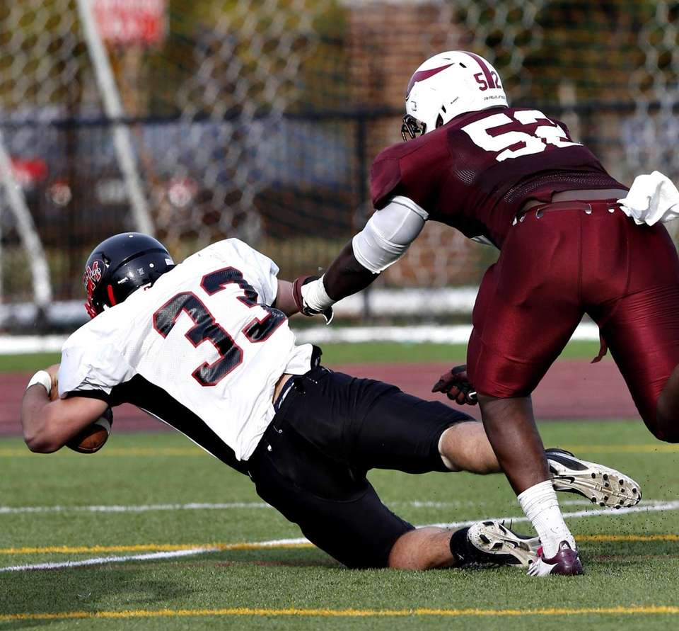 Patchogue's Tylor Conlon dives into the end zone