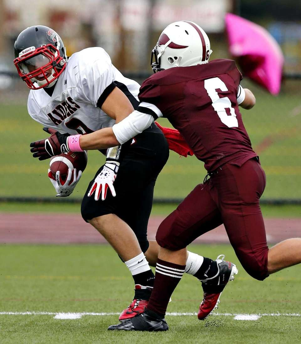 Patchogue's Connor Coughlin advances the ball after a