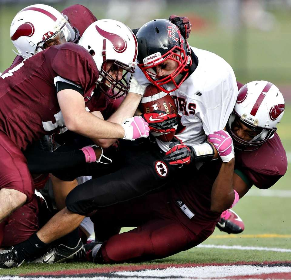 Patchogue's running back Samuel Campanella is brought down