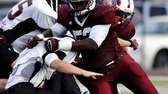 Bay Shore linebacker Ousmane Camara brings down Patchogue