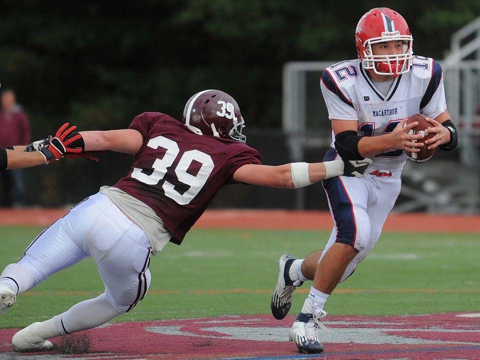MacArthur High School quarterback Gerard Cunningham, right, tries