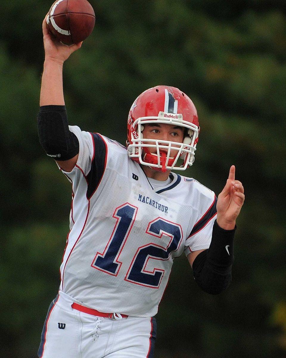 MacArthur High School quarterback Gerard Cunningham completes a