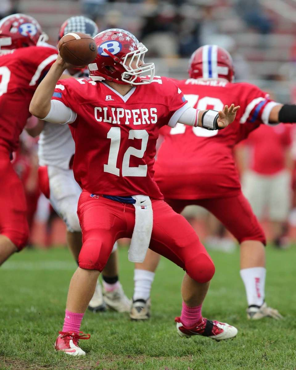 Bellport's Nick Fountis throws deep in the first