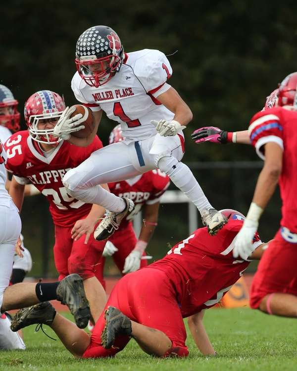 Miller Place's Adin Greenfield jumps over the Bellport