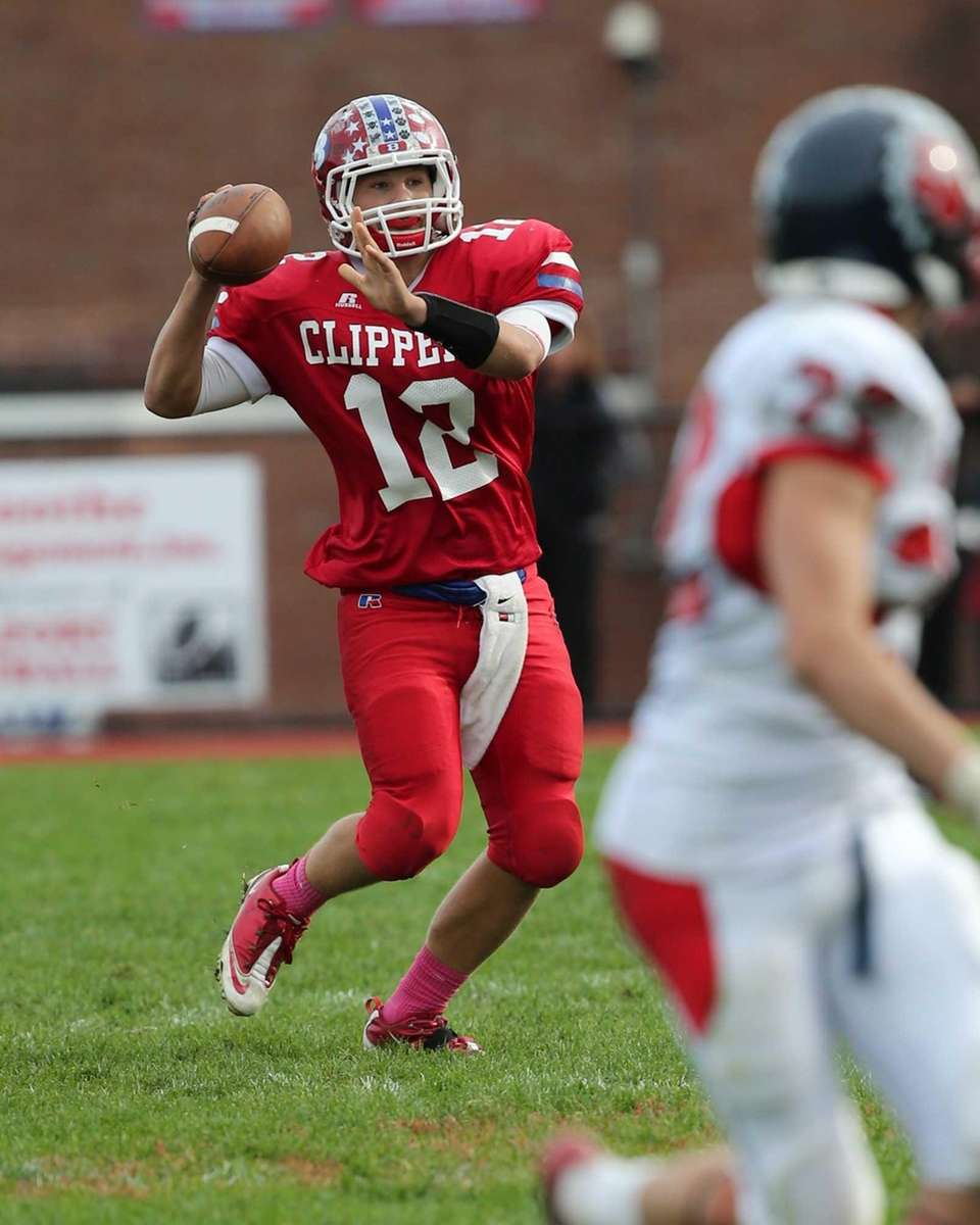 Bellport's Nick Fountis throws for a first down