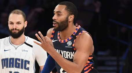 Knicks guard Wayne Ellington reacts after he sinks