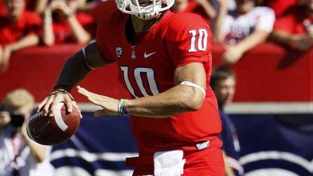 Arizona starting quarterback Matt Scott scrambles during the