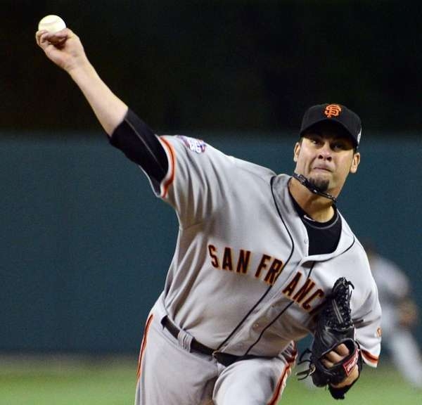 San Francisco Giants starting pitcher Ryan Vogelsong delivers