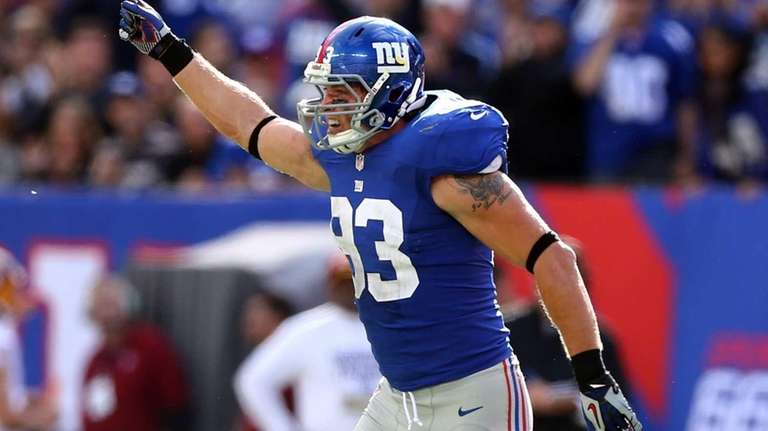 Chase Blackburn celebrates after the Giants recovered a