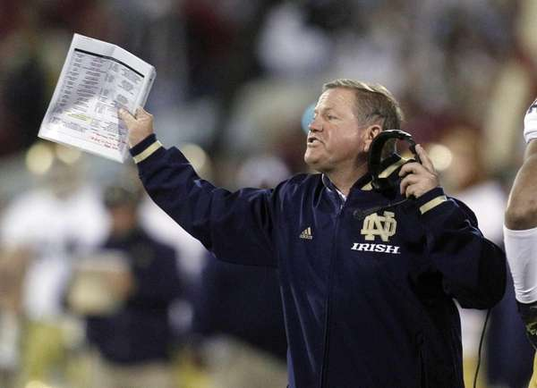 Notre Dame head coach Brian Kelly shouts from