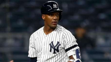 Miguel Andujar of the Yankees strikes out to
