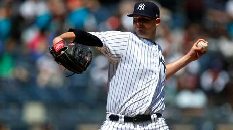 Jordan Montgomery of the Yankees pitches in the