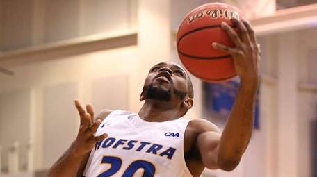 Hofstra guard Jalen Ray gets a layup against