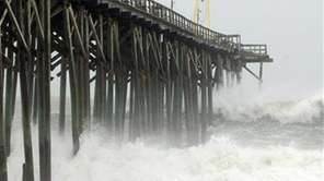 Waves pound Carolina Beach pier in Carolina Beach,