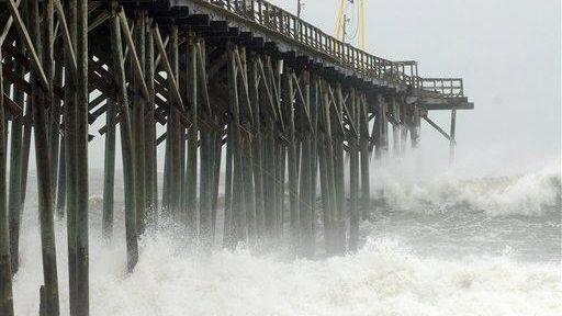 Waves pound Carolina Beach pier in Carolina Beach,