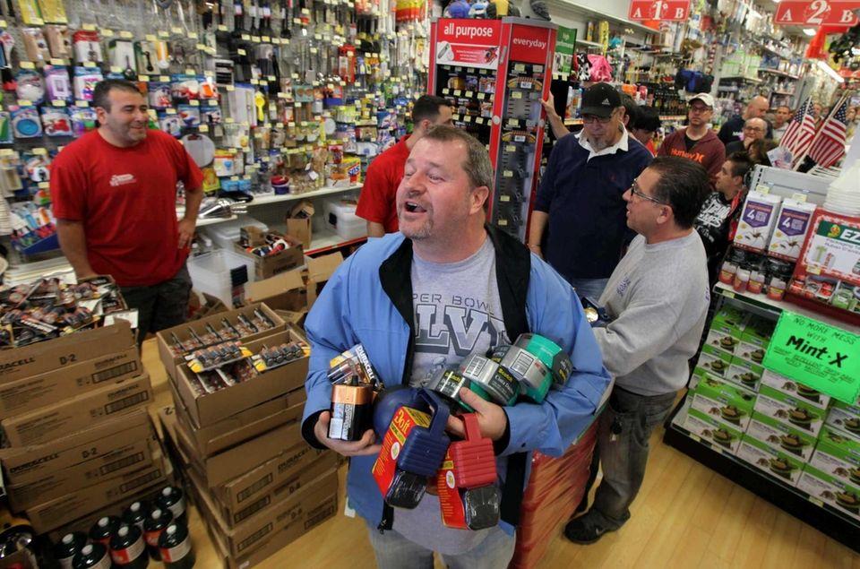 John Bretschneider of Melville bought flashlights, batteries, and
