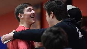 Jack Cleary of Plainedge gets congratulated after bowling